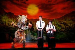 "Phyre Hawkins, Mark Evans and Christopher John O'Neill in ""The Book of Mormon"". Photo by  Joan Marcus."