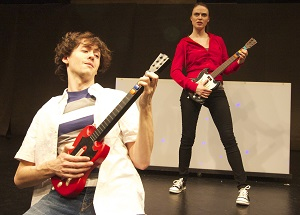 Morton (Mark Benzel) and Haley (Susanna Stahlmann) rock out with Guitar Hero. Photo by Liz Josheff.