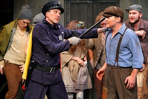 Officer Lockstock (Bradley Greenwald) and Bobby Strong (Patrick Morgan) with URINETOWN company. Photo by Michal Daniel.