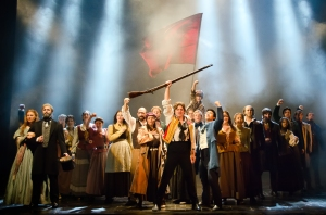 Ensemble, including Cosette (Lauren Wiley) and Jean Valjean (Peter Lockyer) on the left, and Enjolras (Jason Forbach) and Marius (Devin Ilaw) in the center. Photo by Kyle Froman.