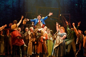 Ensemble, including Thénardier (Timothy Gulan) in center, and Madame Thénardier (Shawna M. Hamic) to the right. Photo by Deen van Meer.