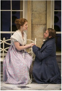 Ashley Rose Montondo (Elizabeth Bennet) and Vincent Kartheiser (Fitzwilliam Darcy) in the Guthrie Theater's production of Pride and Prejudice, by Jane Austen, adapted by Simon Reade. Directed by Joe Dowling, set design by Alexander Dodge, costume design by Mathew J. LeFebvre and lighting design by Philip S. Rosenberg.  Photo by Michael Brosilow.