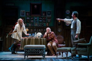 "Jim Lichtscheidl (Ilya ""Waffles"" Telegin), Andrew Weems (Ivan ""Vanya"" Voynitsky) and John Catron (Mikhail Astrov) in Uncle Vanya. Photo by Joan Marcus."