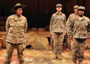 "Army drill sergeant Santiaga Florez (Rhiana Yazzie) trains recruits (l to r: Dawn Brodey, Shana Berg, Jamecia Bennett) in ""Lonely Soldiers: Women at War in Iraq"" at History Theatre. Photo by Scott Pakudaitis."