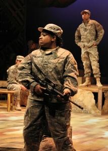 "Soldier Terris Dewalt-Johnson (Jamecia Bennett) in ""Lonely Soldiers: Women at War in Iraq"" at History Theatre. Photo by Scott Pakudaitis."