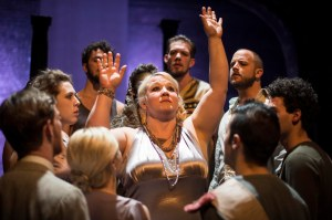 Laura Leffler-McCabe as Jocasta, surrounded by the ensemble. Photo by Carl Atiya Swanson.