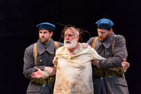 Tyler Miller (Soldier), Stephen Yoakam (King Lear) and Kevin Gotch (Soldier) in the Guthrie Theater's production of King Lear, by William Shakespeare and directed by Joseph Haj. Scenic design by Marion Williams, costume design by Jennifer Moeller, lighting design by Jennifer Tipton. Photo by T Charles Erickson